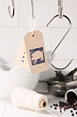 Butcher's hooks, labels, kitchen twine and peppercorns