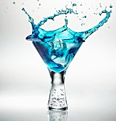Ice Cube Splashing into a Blue Raspberry Martini