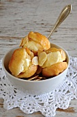 Vetkoek (South African deep-fried pastry) with cream cheese and slivered almonds