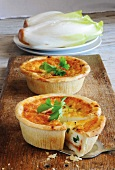 Chicory quiches with spring onions and tomatoes