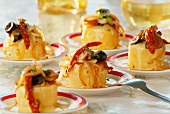 Orange cakes with dried tomatoes and onions