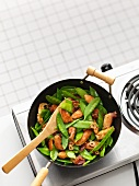Chicken and mange tout in a wok