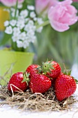 A table decoration featuring strawberries on straw