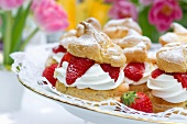 Profiteroles filled with strawberries and cream