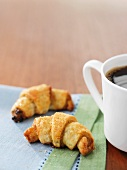 Honey and nut croissants and a cup of coffee