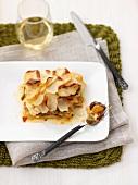 Fish and potato bake with onion sauce