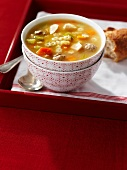 Vegetables soup with noodles and meatballs