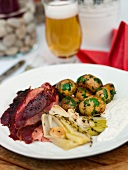 Barbecue leg of wild boar with herb potatoes and leeks