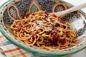 Spaghetti with tomato sauce, pancetta and parmesan