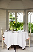 Set table in garden pavilion