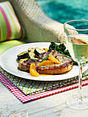 Pork chop with orange and sage sauce
