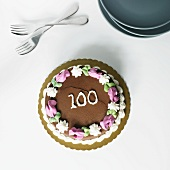 Chocolate Frosted Birthday Cake with the Number 100 On It; From Above