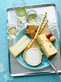 Assortment of Semi Soft Cheeses with Crackers and Bread Sticks; From Above