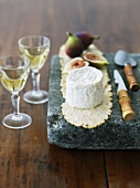 Goat Cheese with Figs on Stone and White Wine