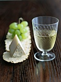 Glass of White Wine with a Wedge of Aged Goat Cheese and Green Grapes
