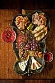 Appetizer Platter with Cheese, Salami, Nuts and Fruit; Red Wine