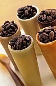 Several beakers of roast coffee beans