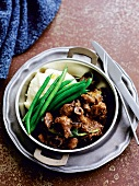 Beef and mushroom ragout with mashed potatoes and green beans