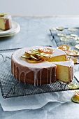 Iced lemon cake decorated with candied citrus fruits