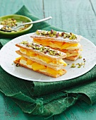 Puff pastry slices with mango, mascarpone and pistachios