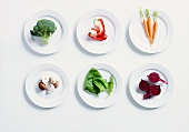 Various types of vegetables on white plates