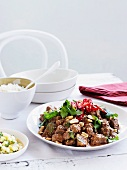 Pork curry with peanuts and pineapple relish