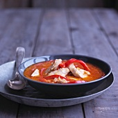 Wintry tomato and coconut soup with chicken