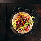 Fajitas with beef, red onions and pepper