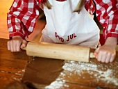 Girl rolling out pastry