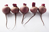 A row of five beetroots