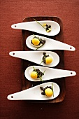 Spoon canapes with quail's eggs and caviar