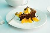 Chocolate tart with orange ice cream and orange fillets