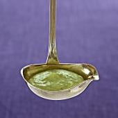 Herb yogurt sauce in a ladle