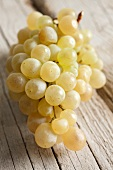 White grapes on a wooden surface