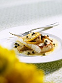 Halibut with artichokes and lemons