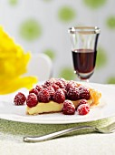 A piece of white chocolate tart with raspberries