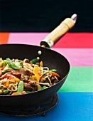 Reindeer, vegetables and noodles in a wok