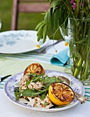 Grilled chicken with lemons, rocket and parmesan