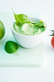 A bowl of basil and lime spread