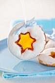 Christmas biscuits with star-shaped candy-filled holes