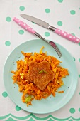 Star-shaped fish patty with grated carrots