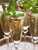 Glasses of champagne with strawberries and fresh mints