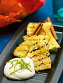 Grilled pineapple with rum, cinnamon and lime yogurt (Caribbean)