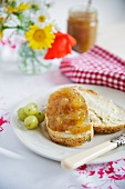 A slice of bread topped with gooseberry jam