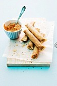 Fried filo dough rolls with tomato-basil dip