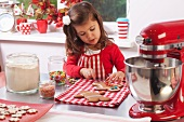 Little girl baking Christmas cookies