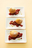 Apple and cinnamon dumplings with cranberry sauce