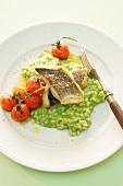 Leek risotto with fish and tomatoes