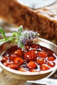 Rowanberry compote in front of a walnut torte