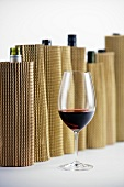 Blind wine tasting: concealed wine bottle and red wine glass